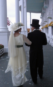 Lisa and Nate stroll the porch of the Grand Hotel