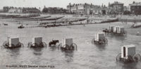 Victorian bathing machines in the water