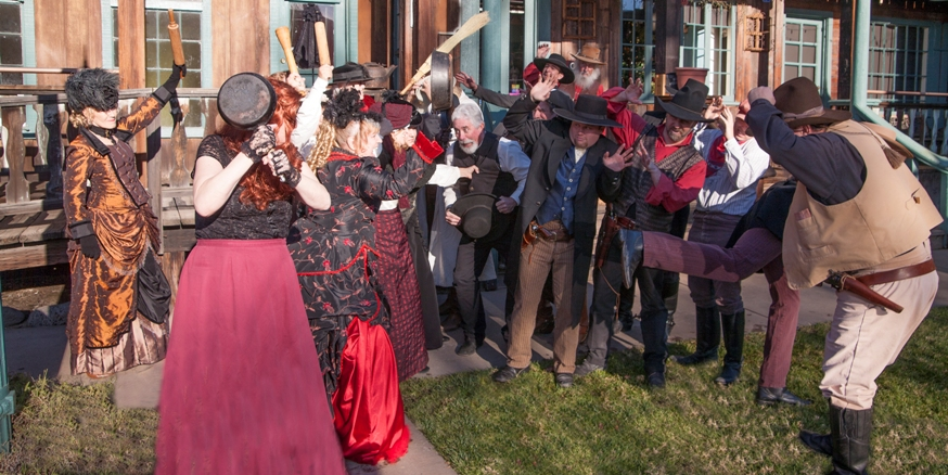 Old Town Temecula Gunfighters - women with rolling pins and men cowering