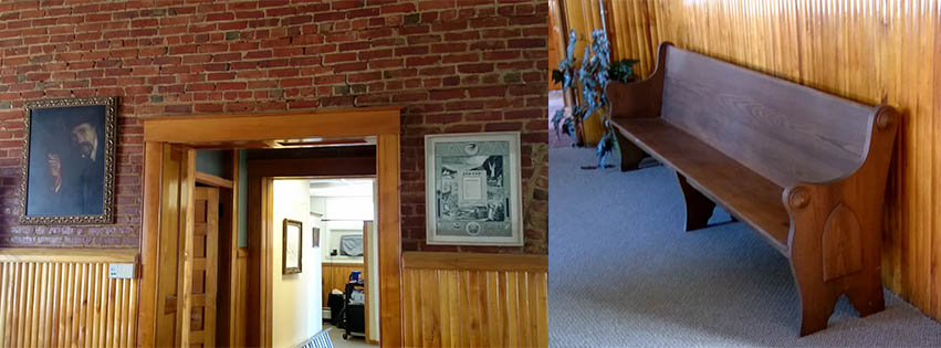 Painting of a man by Christopher Moran hangs on left side of hallway, IOOF membeship certificate hangs on the right; an old pew in the front room on first floor of the Centennial Building