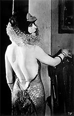 Clara Bow in low cut back dress