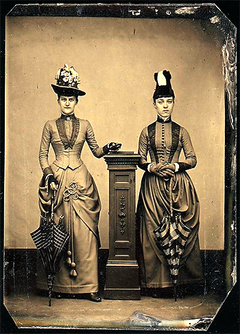 2 women standing for photo - photo caption contest