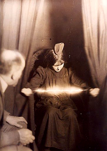 Woman creating eerie light - photo caption contest