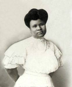 Madam CJ Walker in white dress