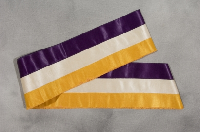 purple, gold, and white suffrage sash