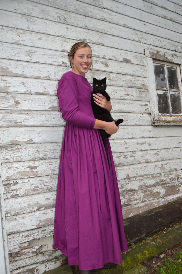 Halloween 2018 Photo Contest entry: Grace W. wearing our Prudence Civil War Styled Dress holding her black cat