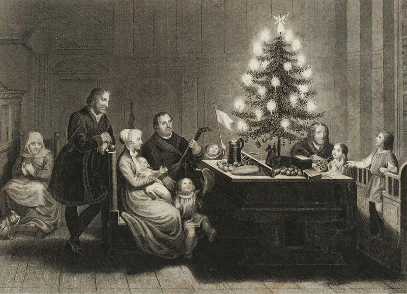 Martin Luther shown with his family beside a candle-lit tree