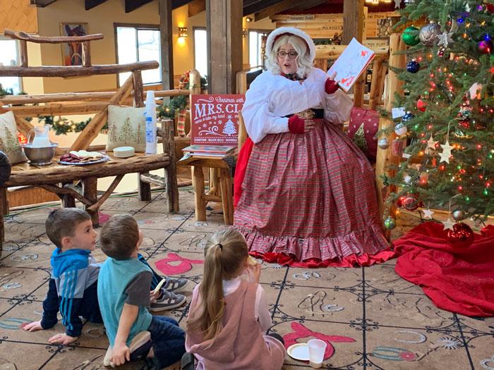 Mrs Santa Claus reading to children