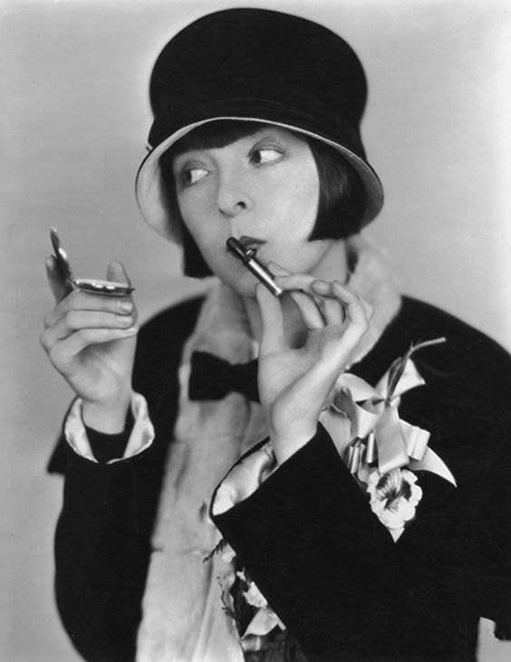 Colleen Moore applying lipstick