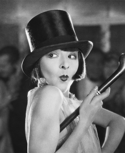 Colleen Moore 'flapping' it up in top hat and cane