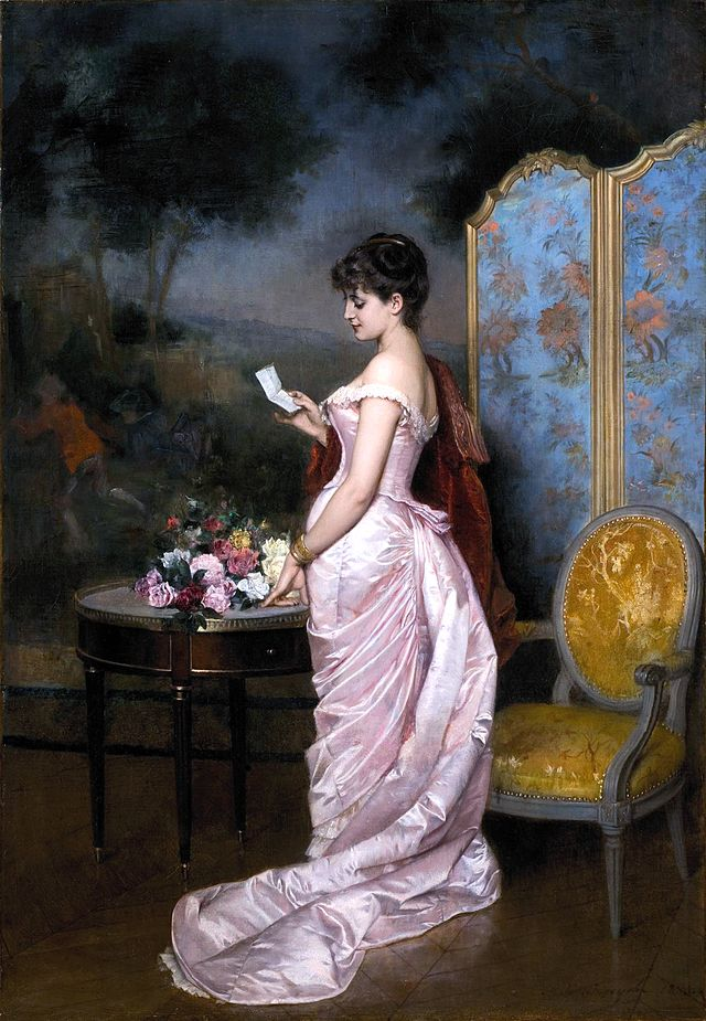 A woman reading a letter in a pink dress