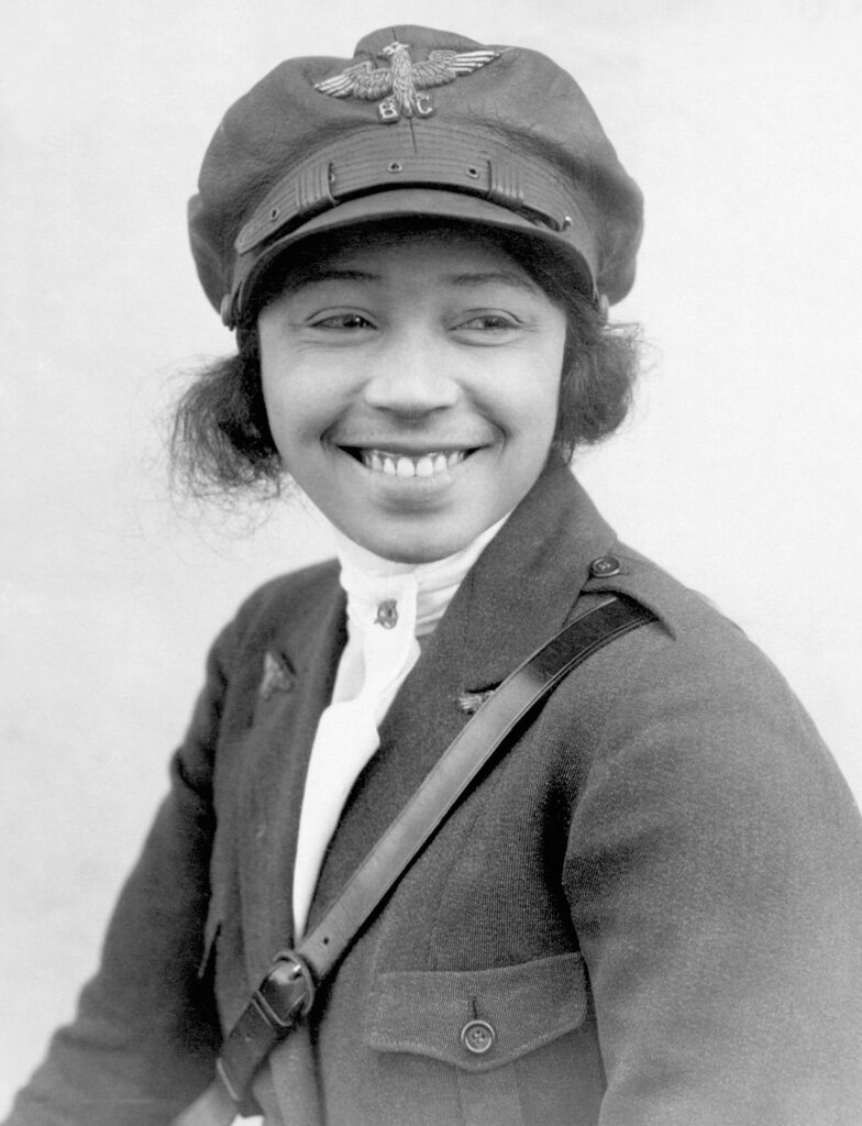 Black and white photograph of Bessie Coleman with pilot's hat